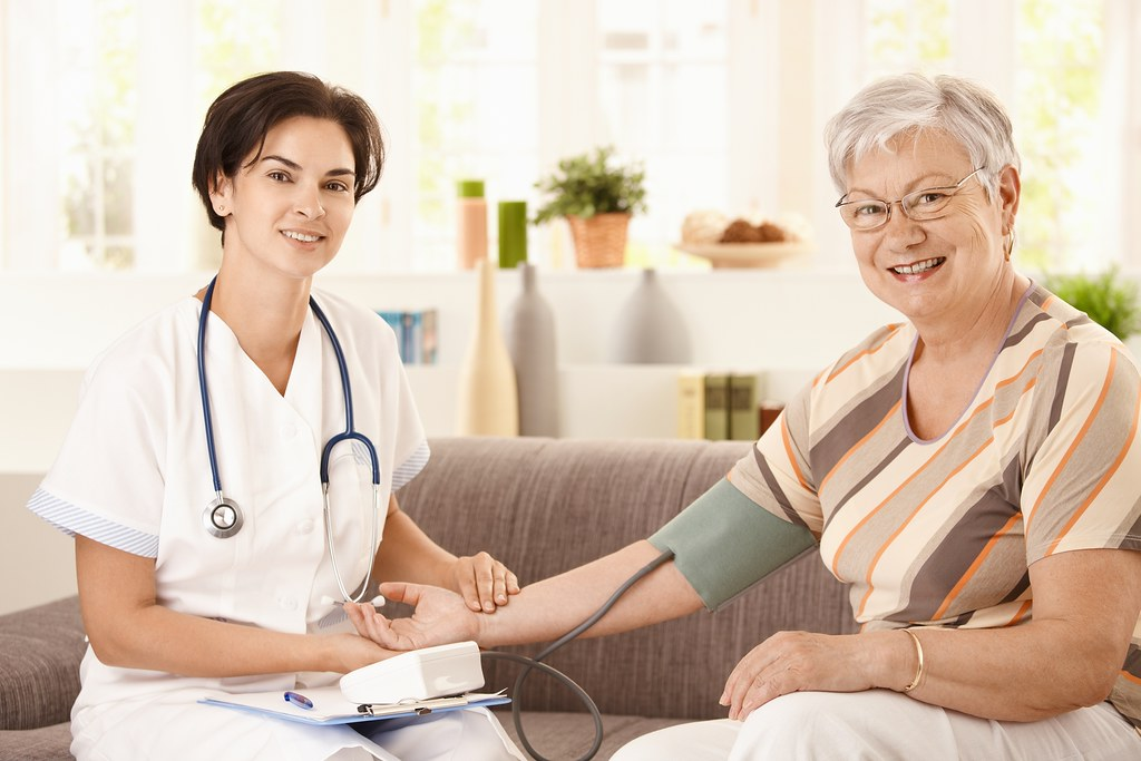 elderly care images nurse measuring blood pressure of senior woman at home lo 3365