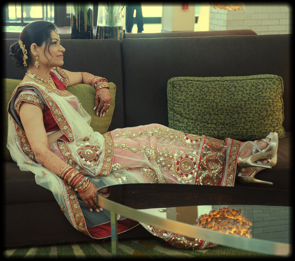 Indian bride relaxing in traditional wedding dress, transp ...