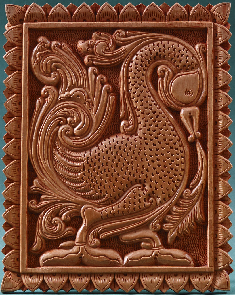 Swan design wood carving of swan design. kandyan art association
