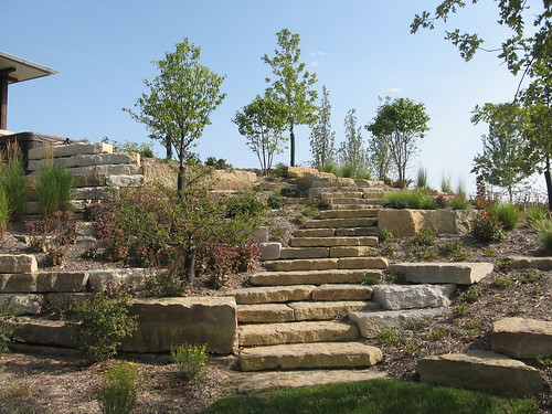 Back yard landscape retaining wall and patio in nebraska for Landscape design omaha