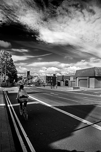 girl on a bike in a street in the morning | by PicarusSlim