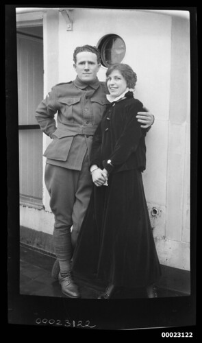 Unidentified man and woman standing near a porthole | by Australian National Maritime Museum on The Commons