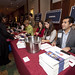 Volunteers help register guests for the Small Business Invitational