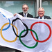 Bob Neill raises the Olympic flag outside Eland House