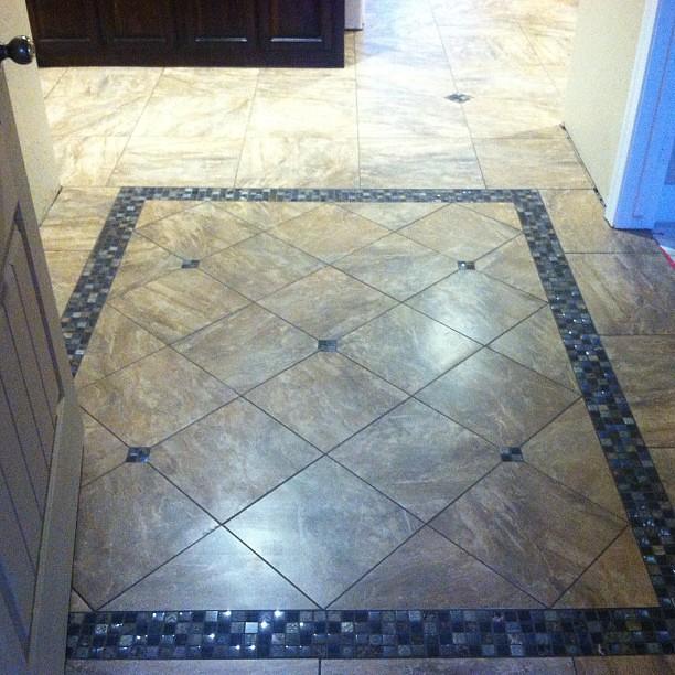 Foyer Tile Job : The tile is almost done nice little foyer design going on