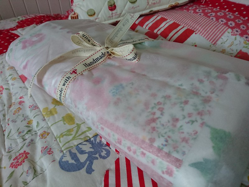'Strawberry Garden', red, pink and white vintage-style baby quilt