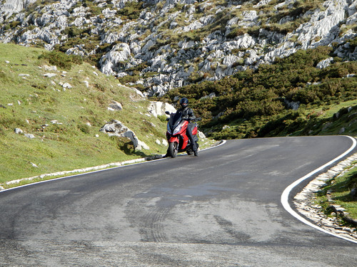 Filming a motorcycle commercial on the winding roads of the mountainous region of Covadonga, Spain