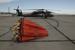 Washington National Guard readys helicopter and water bucket for deployment to Taylor Bridge Fire | by Washington State Department of Natural Resources