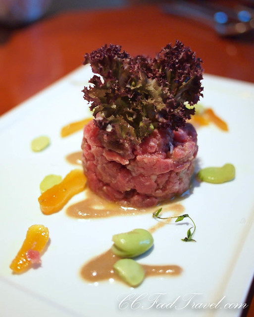 Beef tenderloin tartare with fresh fava beans, marinated apricot and ...