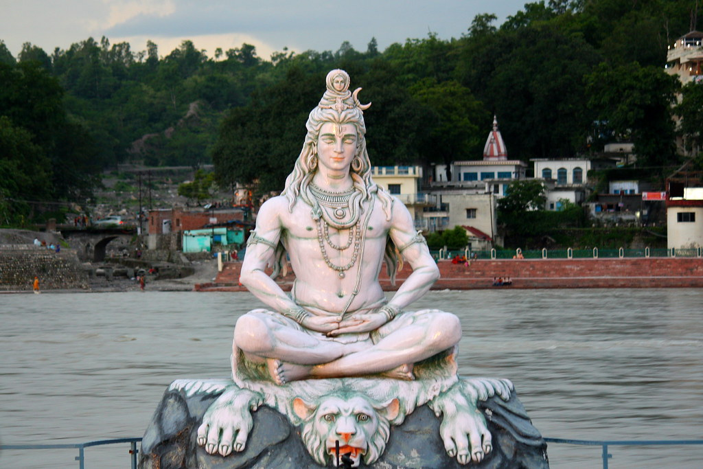 Idol of Lord Shiva on the banks of river Ganges in Rishike ...