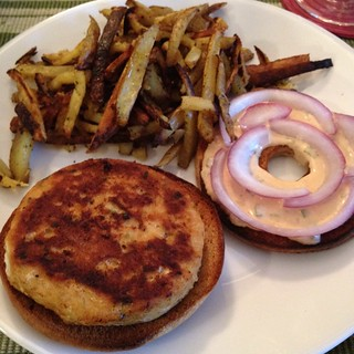 Salmon burger on a bagel with Old Bay fries | by Texarchivist