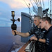 Aerographers check wind speed aboard ship.
