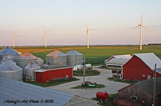 A country sunset illuminates Iowa wind farm. | by NA Windpower