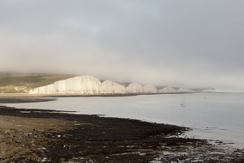 Eastbourne to Seaford - 78 | The Seven Sisters in low cloud and evening sun | by Paul Dykes