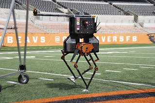 ATRIAS, a two-legged robot created at Oregon State University, ambles down the sideline at Reser Stadium, home of Beaver football. (Photo courtesy of Oregon State University) | by Oregon State University
