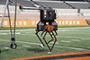 ATRIAS, a two-legged robot created at Oregon State University, ambles down the sideline at Reser Stadium, home of Beaver football. (Photo courtesy of Oregon State University)