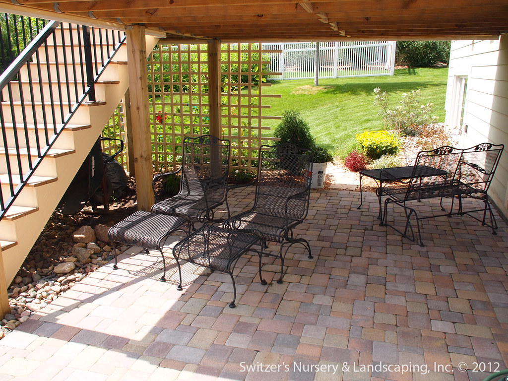 paver patio under deck with retaining wall steps minnesota landscaping ideas by switzers - Patio Under Deck