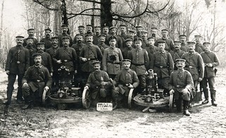 A heavily moustached group of men from II Bataillon Minenwerfer-Abteilung pose for a memento photograph behind a pair of 7.58cm Leichter Minenwerfer n/A | by ✠ drakegoodman ✠