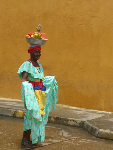 Lady carrying fruit on her head