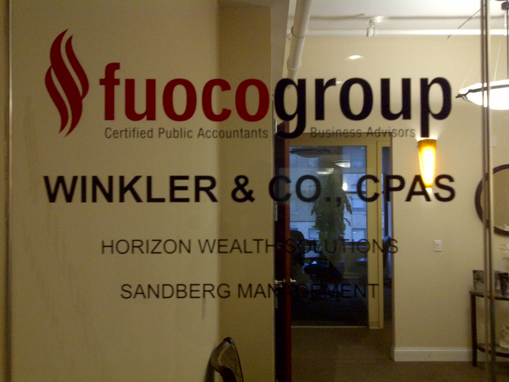 Vinyl lettering on glass door fuoco group vinyl letters for Door vinyl design