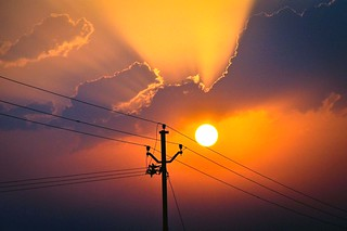 Sun Rising on Power Line | by anandamoy