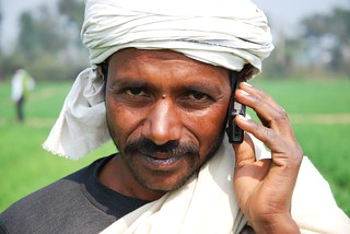 Farmer with his mobile phone in Bihar, India | by CIMMYT
