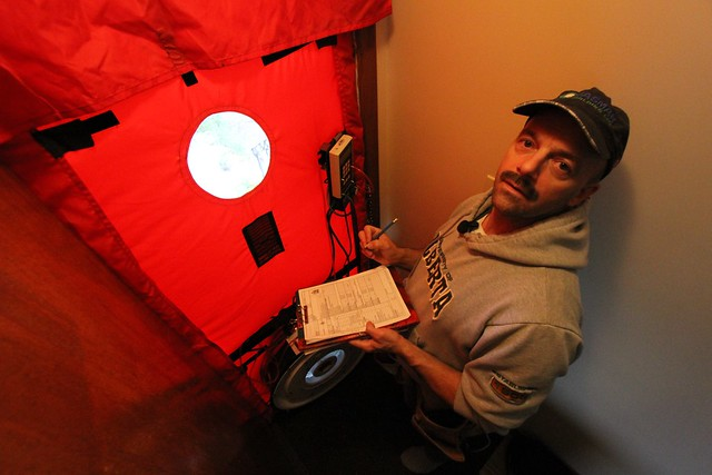 Energy auditor Rob Gawreletz checks the home for air leaks with this blower that fits over the doorway
