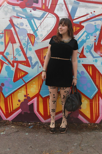Black and tan outfit: thrifed 1990s black velvet mini dress, Jeffrey Campbell flatforms, American Apparel punctuation tights, leopard print horse-hair belt, studded-bottom belt, Peter-Pan collar necklace | by Célèste of Fashion is Evolution