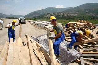 Workers building a new road | by World Bank Photo Collection