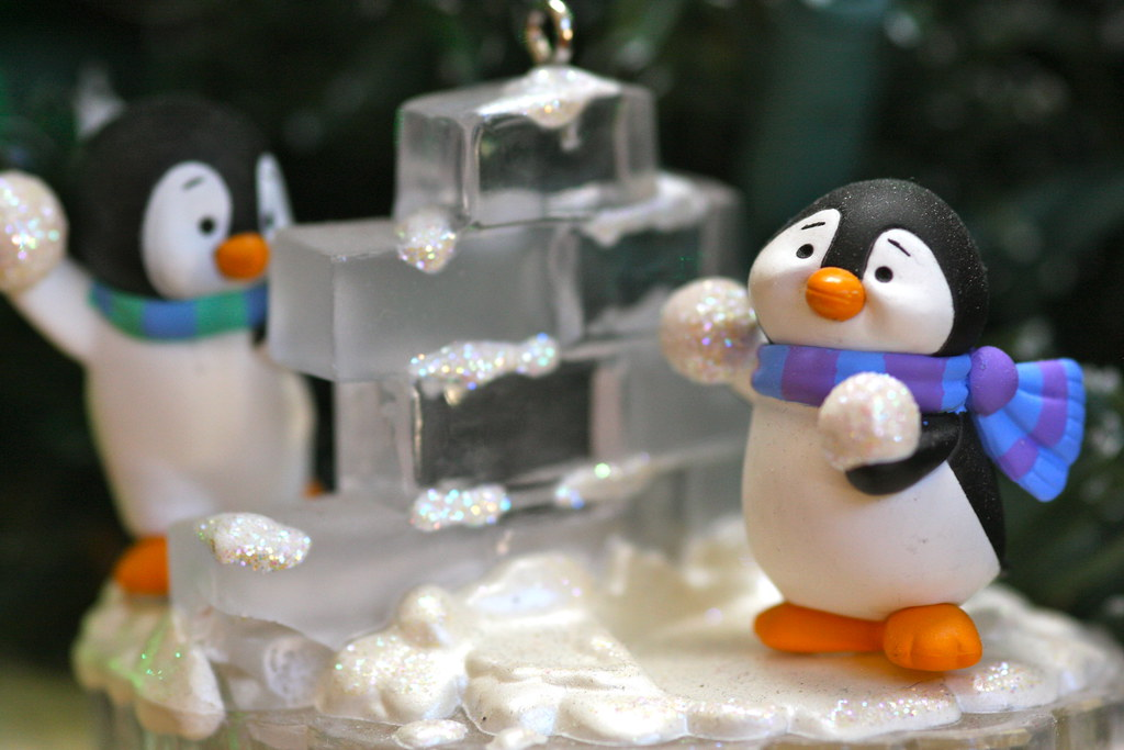 christmas decorations penguins building an igloo by kevin dooley