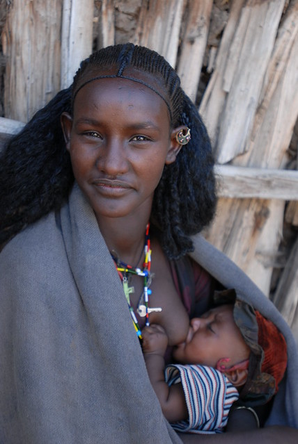 Mother feeding breast milk to her child in Ethiopia