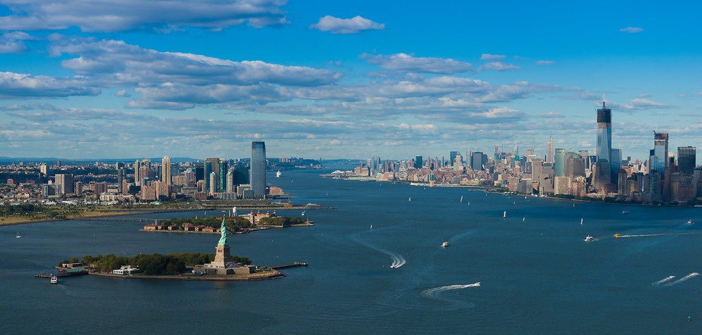 Aerial Panorama Of Manhattan Statue Of Liberty And Hudson