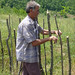 A farmer works to construct fences around his land