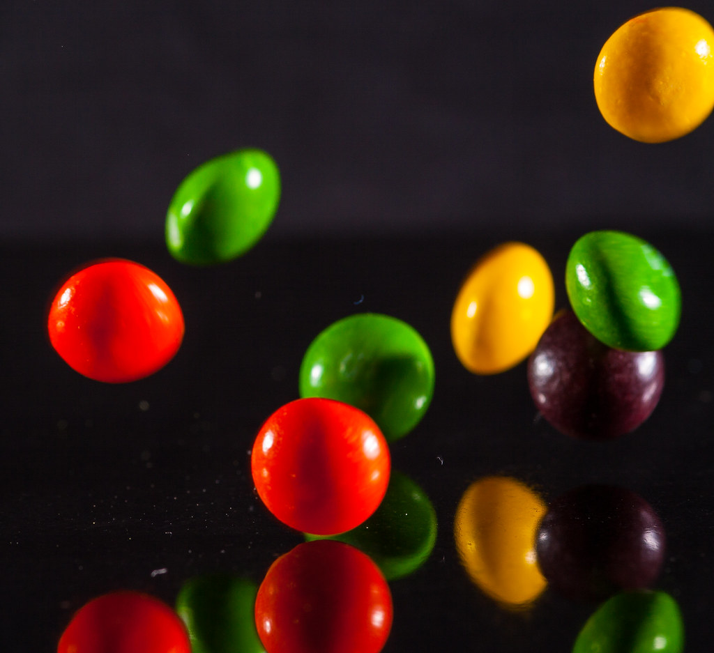 it s raining skittles skittles dropped onto a reflective b flickr
