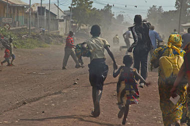 Congolese fleeing from the eastern city of Goma which was reportedly siezed by the M23 rebel group. The UN Security Council has condemned the rebel actions although peacekeepers dispatched by the world body were in the area. | by Pan-African News Wire File Photos