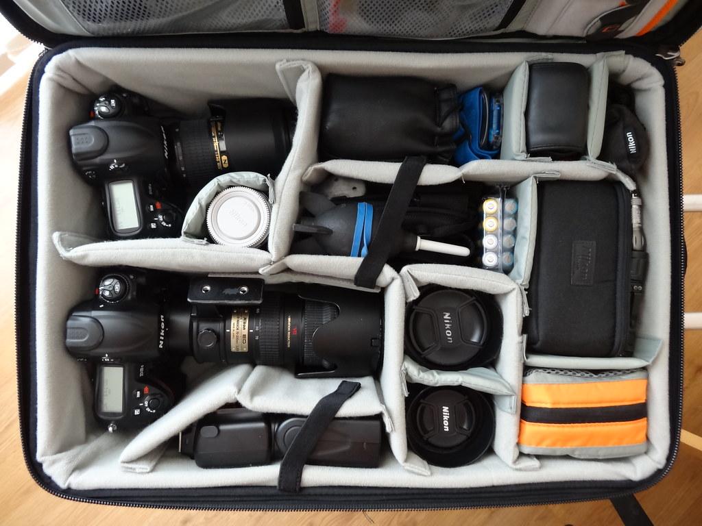 Inside a professional wedding photographers camera bag lo for Wedding photographer camera bag