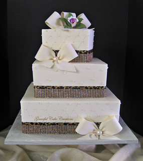 wedding cake with bows and bling ivory buttercream wedding cake with bling ribbon a 26837