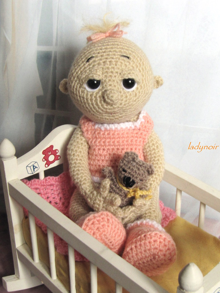 Crocheted Baby Doll Little baby girl sitiing in her baby ...
