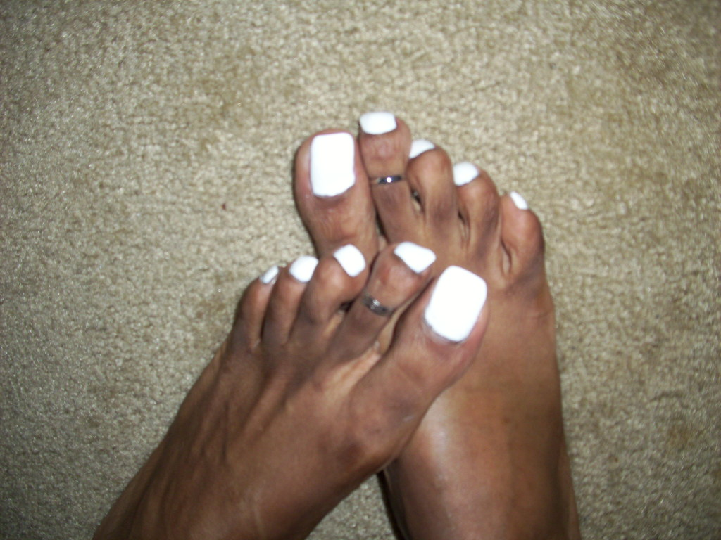 White Nail Polish And Cute Toe Rings