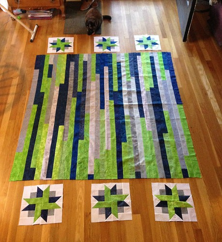 Expanding the jelly roll race quilt top with ribbon star quilt blocks