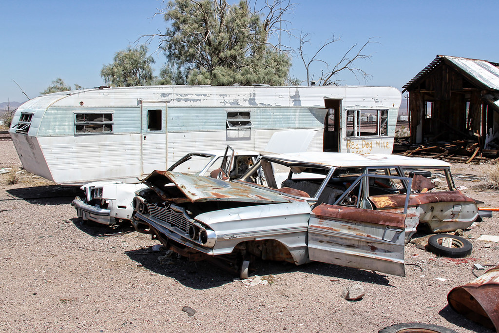 Trailer Trash | A very tortured pair of cars rest near an ab… | Flickr