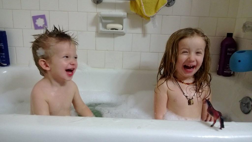 Naked girl taking a bath
