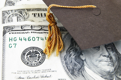 mini graduation cap on money | by SalFalko