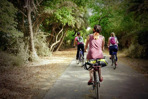 Western tourists cycling in India | by Flora_AB