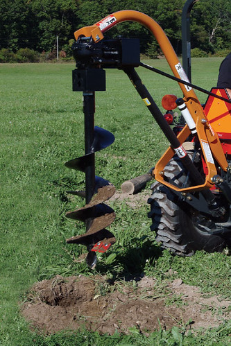 how to use a post hole digger in rocky soil