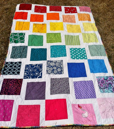 A quilt I made for my niece, using this tutorial: http://www.hookedonneedles.com/2011/09/rainbow-quilt-picture-tutorial.html | by wonderlandbyalyce