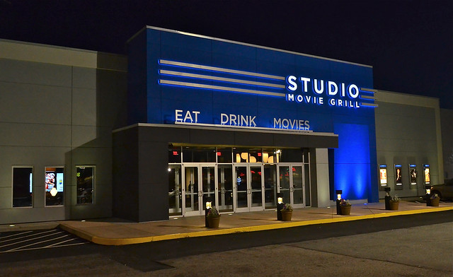 Studio Movie Grill Application & Careers Studio Movie Grill combines a movie theater and a restaurant. Food and drinks, including alcoholic drinks, are served to customers as they watch a movie.