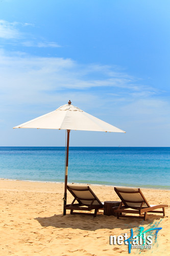 Sunbeds and umbrella on the beach | by Netfalls