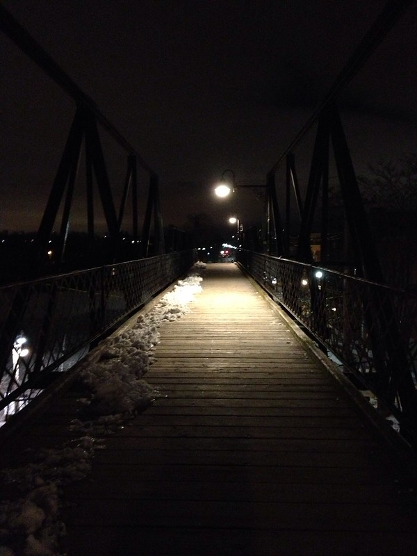 Walking over wallace bridge at night
