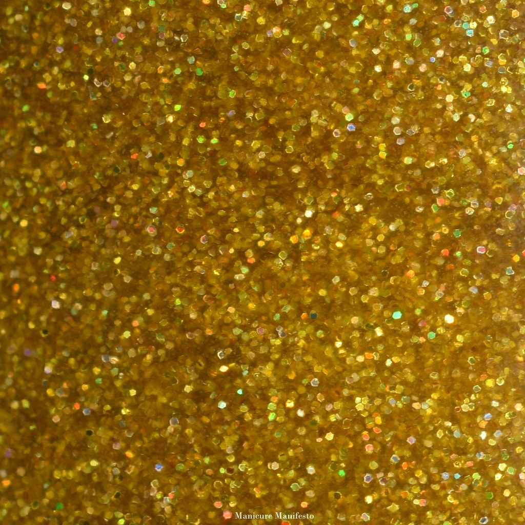 Yellow glitter nail polish